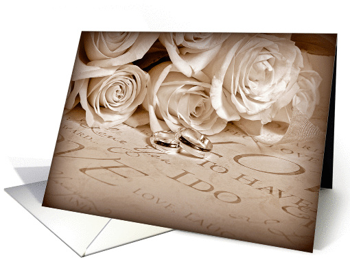 wedding rings with rose bouquet with sepia frame card (623447)