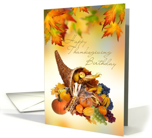 Birthday on Thanksgiving day card with Cornucopia and leaves. card