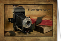 Retirement for photographer-vintage bellows camera with roll of film card