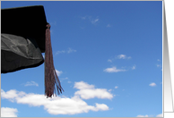 Black graduation cap with tassel in blue sky card