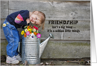 smiling little girl with watering can for friendship card