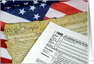 U.S.Constitution and income tax form on flag card
