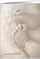 new grandchild congratulations with soft baby feet in sepia card