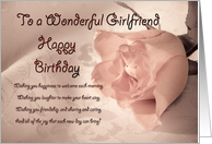 A birthday card for girlfriend. A pale pink rose on a delicate lace background card
