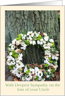 Loss of uncle - White flower wreath near tree card