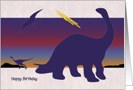 Silhouette Dinosaurs in Front of Fiery Sunset Birthday Card