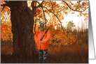 Deer dressed as a hunter with rifle in autumn woods card