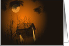 Haunted old cabin in woods with glowing orange moonlight card
