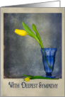 Yellow tulip in blue glass for sympathy card