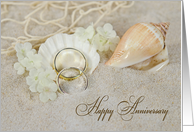 Wedding Anniversary, wedding rings and seashells in beach sand card