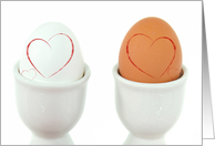 Anniversary red hearts on hard boiled eggs in white cups card
