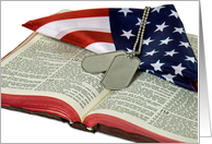 military dog tags on Holy Bible with flag for Veterans Day card