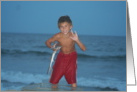 Sign Language at the beach, boy with fish card