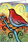 Red bird on a branch in spring card
