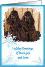 Holiday Greetings, two chocolate American Cocker Spaniels with blue snowflakes card