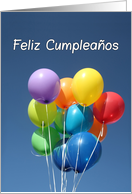 Spanish Birthday, Feliz Cumpleaños, Colored Balloons in Blue Sky. This card