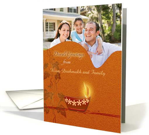 Photo Diwali Greetings with decorative oil lamp on brown orange card