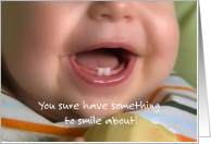 Congratulations on baby's first tooth. Baby smile and two new teeth. card