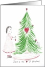 Girl Decorating Christmas Tree with Hearts card