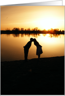 Kissing couple in Sunset card