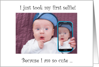 Baby's first selfie, cute smiling baby with mobile. card