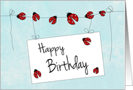 Ladybugs on Line with Sign for Happy Birthday card